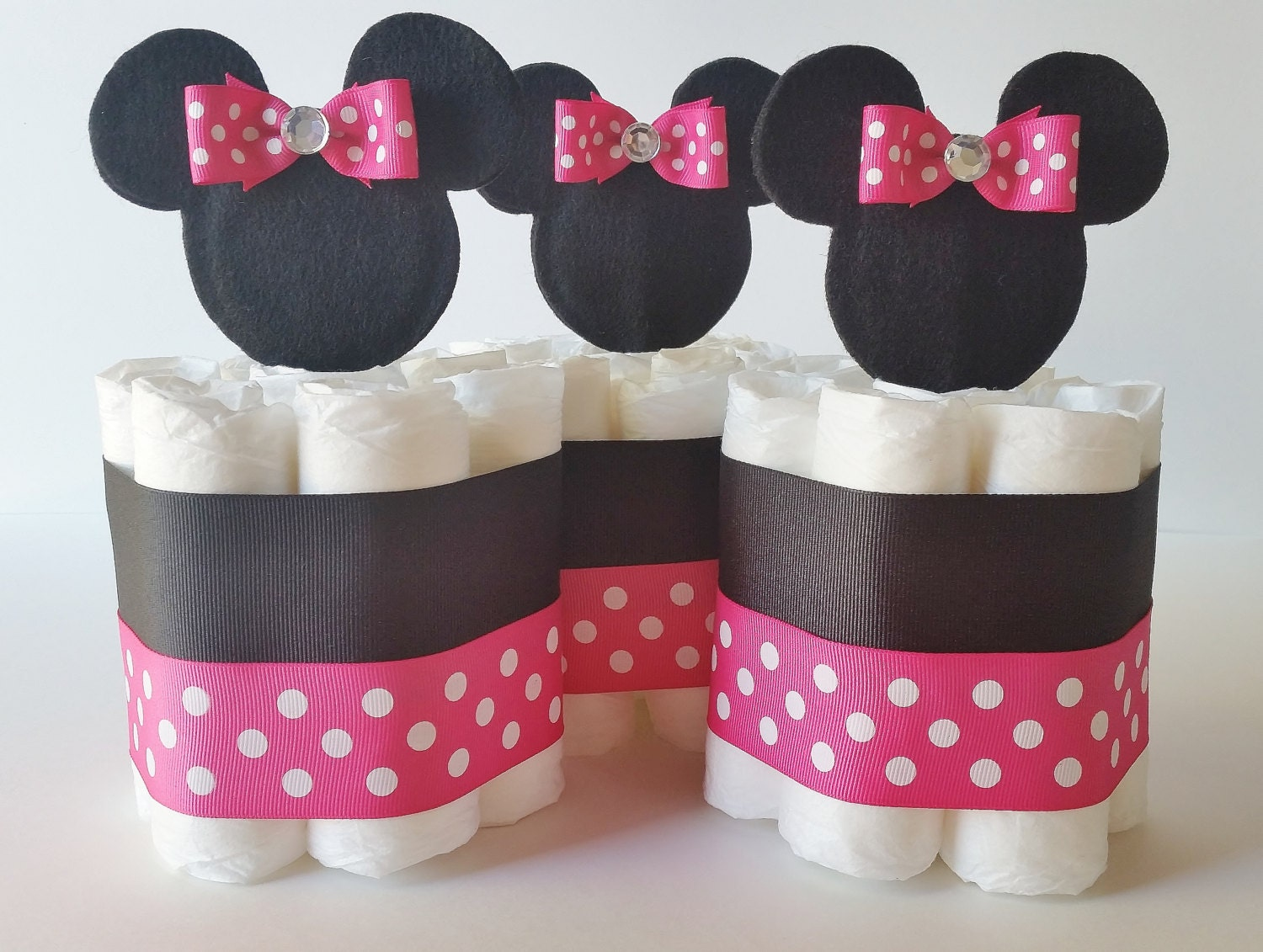 Minnie mouse diaper cake centerpieces minnie mini diaper for Baby minnie decoration ideas