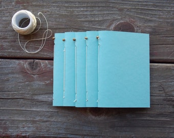Aqua Mini Travel Hand-sewn Notebook. Blank pages. 5 different page colors. 20 pages.