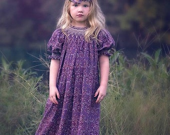 Purple paisley girls smocked dress. The smocking around the neck line is done in cream color, absolutely divine.  Size 3 Months to 5 y 17808