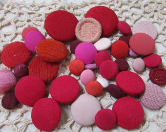 Large lot of vintage covered buttons- reds, burgundy  and pinks  lot of 40