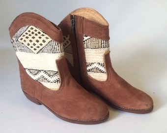 Handcrafted suede, vintage kilim zipper boots.