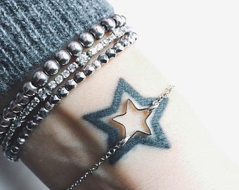 Silver bracelet with silver or gold star mini open