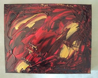 Abstract painting in red gold