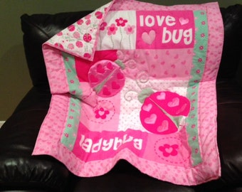 Hand quilted lady/love bug hand made quilt