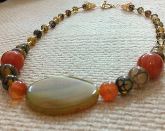 ceres: stone bead necklace of fire & red crackle agate with focal stone of dyed banded agate