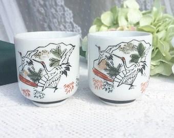 2 Japanese Saki cups, Bowls, Asian, crane, bird,  white, black, mountain, stamped, decor, oriental, orange, green, boho