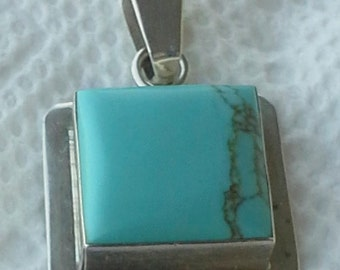 Vintage 1980's Mexico sterling silver and turquoise pendant.