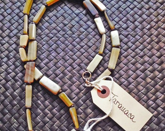 THE TARAUACA NECKLACE - horn shells. coconut beads
