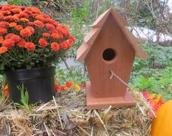 Handmade, upcycled redwood birdhouse