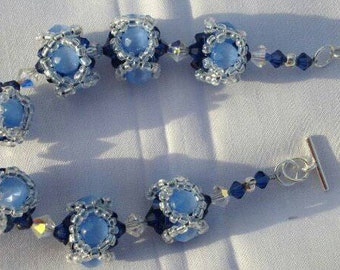 Blue cats eye center woven bracelet with handmade beads, swarovski crystal, sterling silver, toggle clasp, crystal bracelet