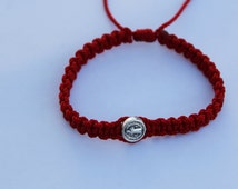 Saint Benedict red bracelet made from sturdy nylon string.