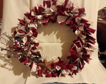 12 inch Primitive Americana rage wreath with rusted tin star and pip berries