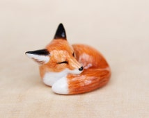 sleeping red fox figurine