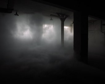 Chiaroscuro photography of smoke in an abandoned factory in France