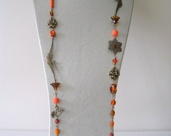 costume jewelry necklace beads orange and brown birds