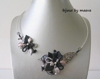 costume jewelry necklace black open foliage