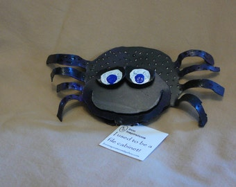 Recycled metal spider with shoes magnet