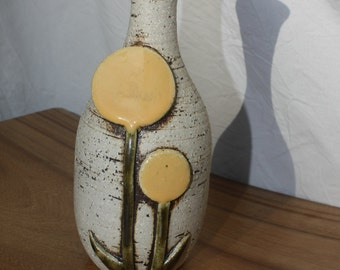 mid century modernist vase with 2 stylized flowers in overlay