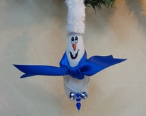Hand painted snowman gourd ornament with blue scarf, holding miniature ornaments by Debbie Easley