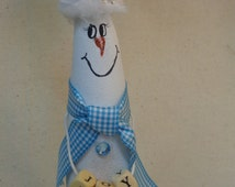 Hand painted snowman gourd ornament holding blocks that spell Joy by Debbie Easley