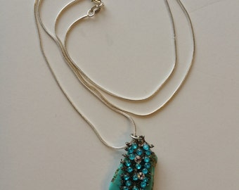 turquoise blue howlite pendant necklace with rhinestones.  26 inch silver chain