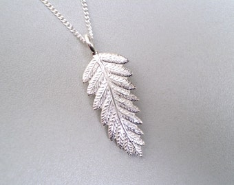 Fine Handcrafted Sterling Silver Fern Pendant. Made in New Zealand by Hudson Jewellery.