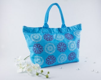 Turquoise canvas deck, travel, beach, book bag, hand dyed and screen printed with ellipse flower pattern in dark purple and white