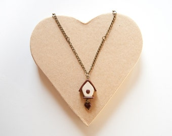 Bronze necklace with pendant polymer clay in the shape of a little house with heart