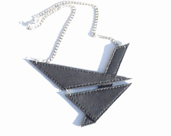 Handmade black leather geometric necklace. Chain and leather jewelry.