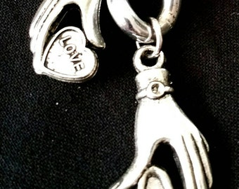 Once a Choke Chain worn by a dog now a Chains for Change Hands that Love Keychain