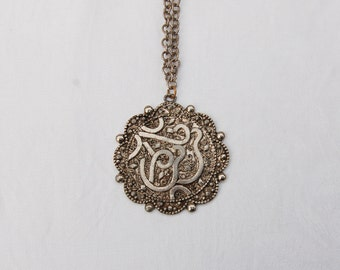 Large Vintage Pendant on thick linked Chain .