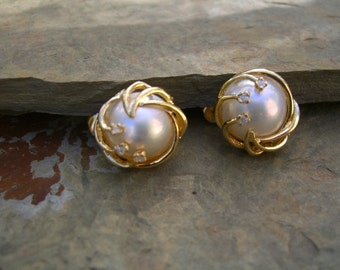 14 karat gold mabe pearl and diamond earrings. Layaway welcome