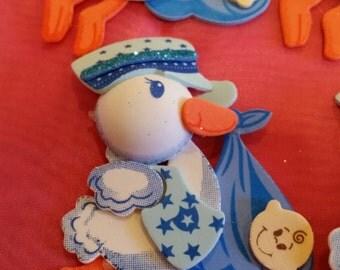 stork,storks,blue stork,blue storks,pink stork,pink storks,baby shower stork,baby shower party favors,baby shower,stork with baby,pacifiers