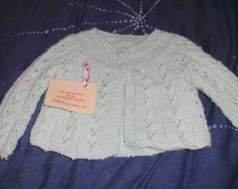 A hand knitted mint cardigan