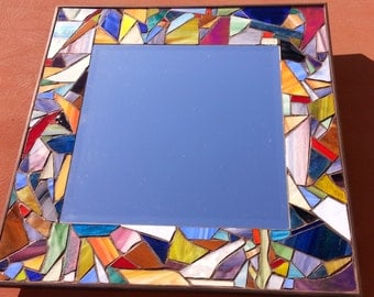 Colorful stained glass mirror with over 100 pieces of glass.