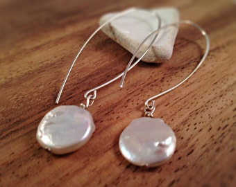 Silver half hoop with raw pearl wire wrapped dangle.