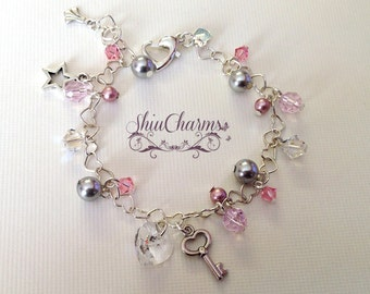 Cute Swarovski Crystal Heartlinked Sterling Silver Charm Bracelet