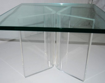 a mid century modern lucite and glass coffee side table