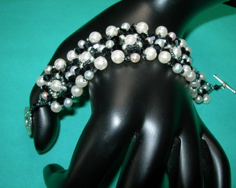 Title: Bracelet weaved with satin beads and Swarovski crystals.