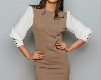 Brown dress. Contrast dress. Clothing business woman. Dress with long sleeves. The sleeves are decorated with buttons