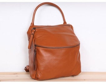 Leraje Convertible Backpack   Shoulder bag - tan brown, made of  rich shrunken leather. wear it as a backpack or shoulder bag