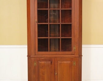 23012E: HENKEL HARRIS 12 Pane Solid Walnut Corner Cabinet