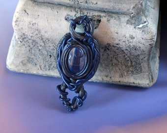 "Black blue polymer clay pendant with glass cabochon and metallic finish - ""Amorphis"""