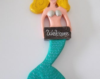 Hand carved mermaid sign