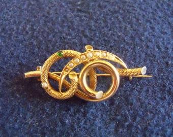 Spilla oro 12 kt borbonica con 9 perline e 1 smeraldo