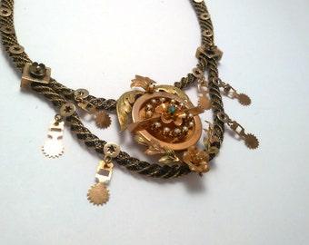 Collier borbonico oro rosa 9 kt a maglia intrecciata, centrale a fiori e foglie con 14 perline e 1 bottone turchese