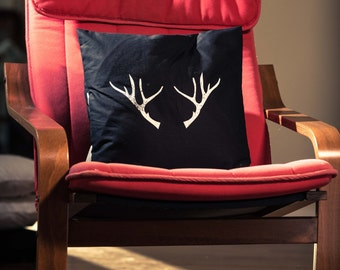Black, one of a kind antler pillow case, finished with buttons, from Spoor Designs