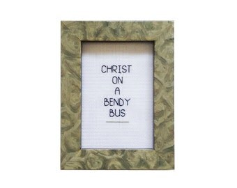 Christ on a Bendy Bus Malcolm Tucker framed cross stitch