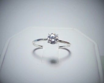 Genuine 5mm Moissanite Solitaire Ring in Sterling Silver