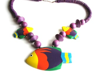 SALE vintage wooden fish necklace . tropical fish jewelry . hand painted fish necklace in purple . statement necklace